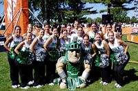 Sparty and the Cheerleaders are in the tailgate lot.