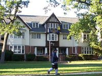 The D U house is a three story tudor mansion.
