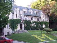 Phi Alpha Kappa is a beautiful 3 story stone mansion that looks like a castle.