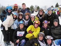 The MU ski team poses as a group on the slopes.