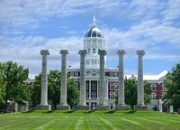 The 6 remaining columns from the front of the building are today's symbol of the schools ability to overcome.  The columns are here in the campus green.