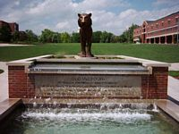 A statue of the Mizzou Tiger sits atop this cool fountain.