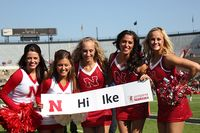 cheerleaders with sign for Ike Maggart