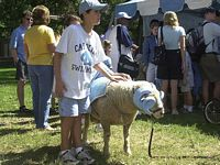 Who brought the goat?  Here a boy pets the Carolina Goat the school mascot.