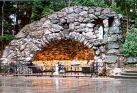 This is a grotto where people light candels and say prayers.  The top of the grotto is arched made of stone and it glows here from the candels.
