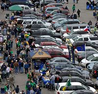 a look down into the parking area from the stadium with endless rows of ND tailgaters.