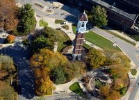 Here is view of the purdue tall brick pointed topped bell tower looking down from the air.