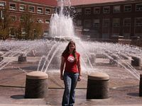 Here a coed [poses in front of one of Purdue's many fountains as she prepares to do a run through.