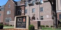 Pictured here is the renovated three story, peaked roof, brick Kappa Sigma mansion.
