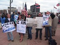 Here are a throng of anti-obama protesters in West Lafayette with Downtown Lafayette in the background.