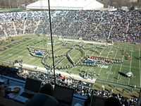 This is a press box view of the Purdue All American Band doing a large design on the firld.